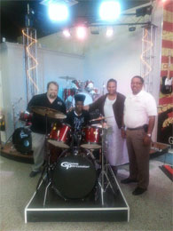 James Adkins Jr receiving drum set